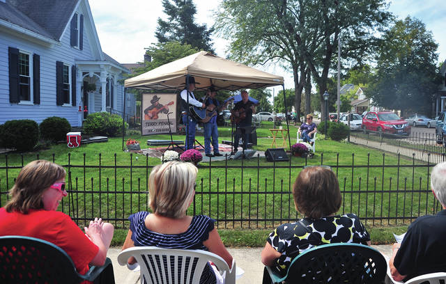 Terry Penkal performs during Saturday's PorchFest in Troy