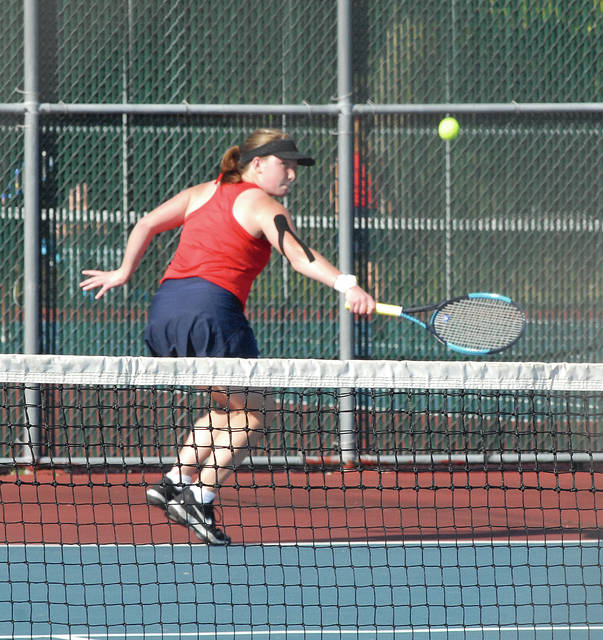 Rob Kiser|Miami Valley Today Piqua's Arabella Partee makes a backhand return at first singles Monday against Tippecanoe's Dakota Schroeder.