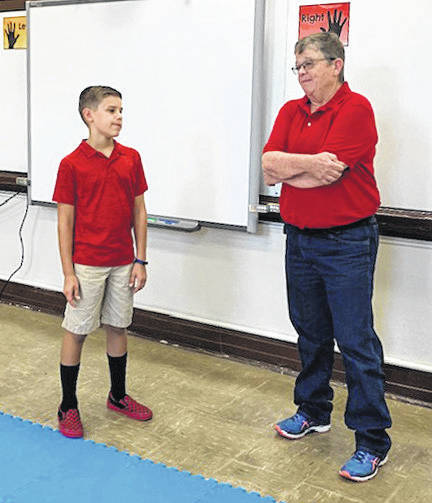 Concord Elementary fourth-grader and student council member Liam Westerfield, son of Kara and Brian Westerfield, gives a tour of the school to visitor, and former Concord student, Jo Wildman, of Dayton.