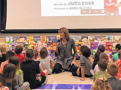 Julia Cook, a former school counselor who now authors children's books, speaks to a group of second- and third-graders during a visit to Piqua's Springcreek Primary Elementary School on Monday.