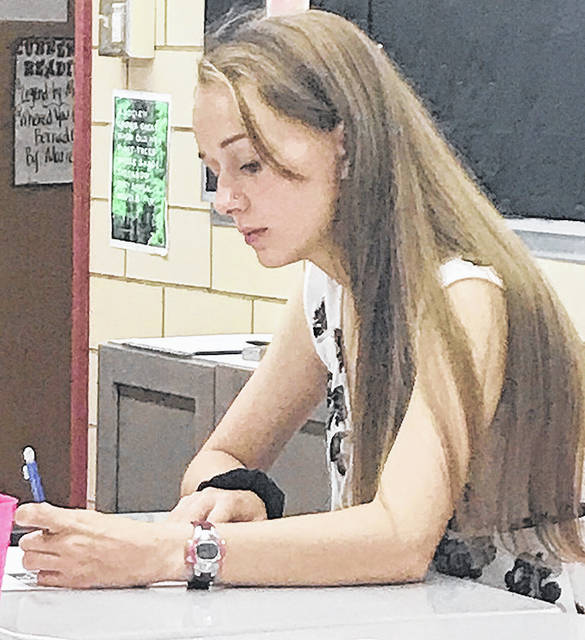 Provided photo Troy High School student Samantha Mascarella works on a drawing during Troy High School's new graphic novels class.