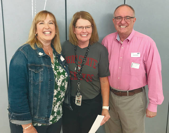 Provided photo Troy High School mathematics teacher Jacqui Lehmkuhl, center, is joined by Troy Area Chamber of Commerce representatives Kathi Roetter, left, and Richard Bender, right, after she learned she had been named the Troy Area Chamber of Commerce's Outstanding Educator of the Year.