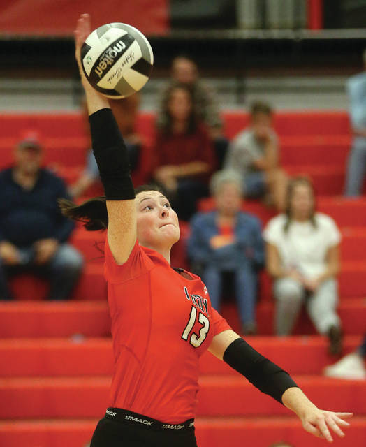 Lee Woolery Miami Valley Today Troy's Lauren Schmitz goes up for a kill Tuesday against Stebbins.