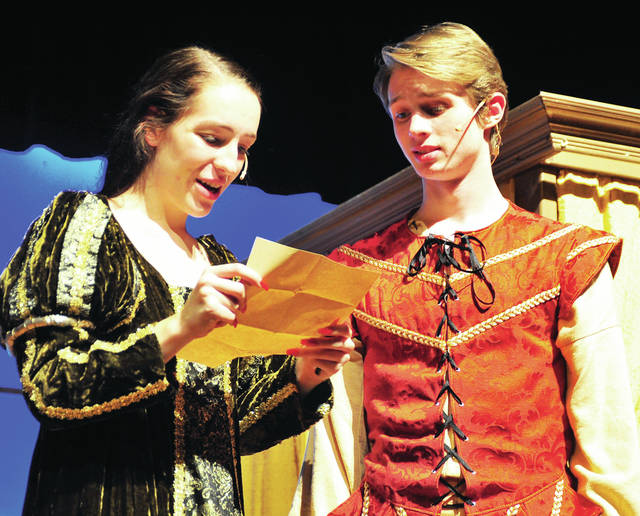 """Troy seniors Angie Rice, left, playing Viola, and Gabriel Shelton, playing William Shakespeare, perform a scene from the Troy High School production of """"Shakespeare In Love"""" during a Tuesday dress rehearsal."""