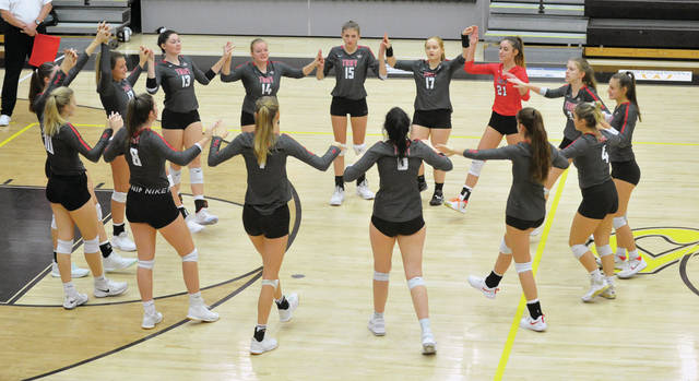 Josh Brown|Miami Valley Today The Troy volleyball team prepares to take on West Carrollton in a Division I sectional tournament matchup Wednesday at Centerville High School.