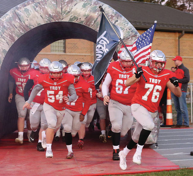 Lee Woolery|Miami Valley Today Troy's Sean Keenan (76) leads the Trojans through the tunnel and onto the field for Friday night's game against Fairborn at Troy Memorial Stadium.