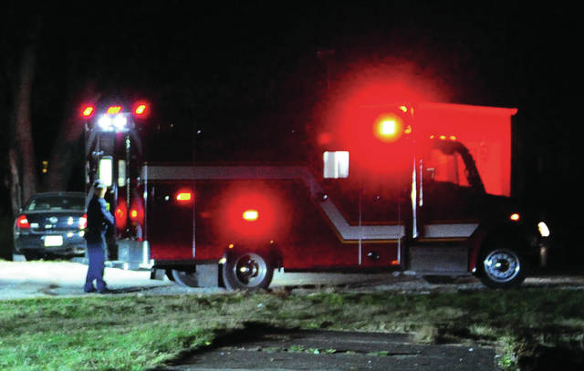 Piqua medics attend to a six-year-old child who was shot in the chest with a CO2 powered pellet rifle on Sunday evening.