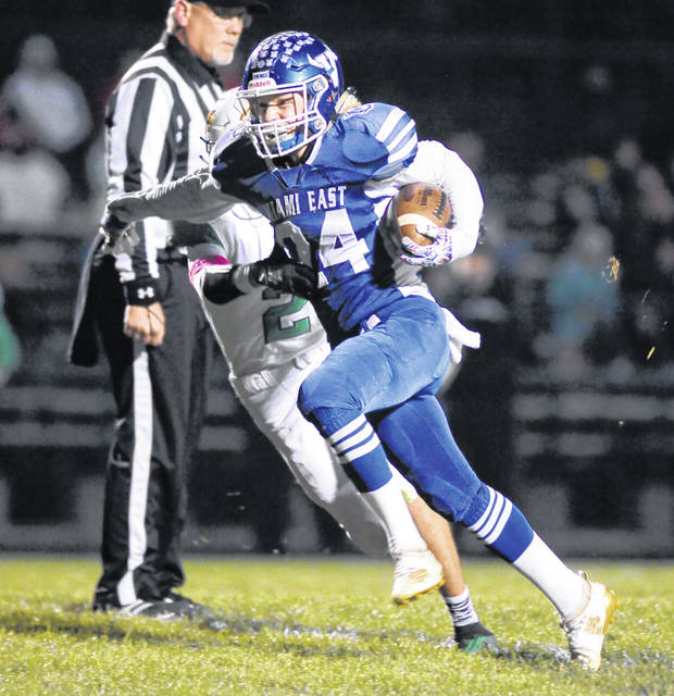 Amanda Prior|Miami Valley Today Miami East's Austin Francis runs the ball Friday against Bethel.