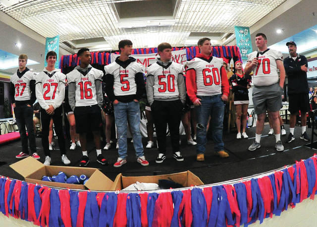 Piqua's senior football players take the stage during the annual pep rally as the Indians get fired up to beat Troy on Friday night. The rally was moved to the Miami Valley Centre Mall due to rain.