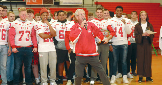 Lee Woolery | Miami Valley Today Troy Mayor Mike Beamish gets the crowd fired up during a pep rally Thursday evening prior to the Troy vs. Piqua football game in the gymnasium of Troy High School. The two teams will meet for the 135th time tonight at Troy Memorial Stadium. Troy (7-2, 6-1 Miami Valley League Miami Division) and Piqua (5-4, 5-2 MVL Miami) will battle for not only a share of a division title, but also playoff positioning.