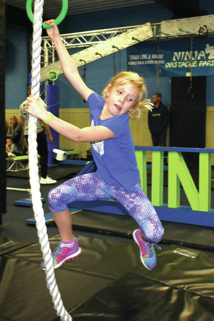 "Last year, hundreds of children traversed the Ninja Obstacle Course fundraiser at Troy Rec. The event returns to Troy Nov. 1-2. Cathy Hudson, 9, of Troy swings from the ropes during the ""Troy Rec Ninja Obstacle Challenge"" last year."