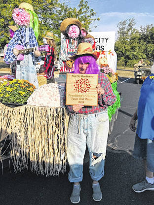 Provided photo The Tipp City Seniors Inc. were prepared for Tipp's annual Mum Festival with their decorated porch and float that won the President's Choice Award, shown off by Judy Groszewski.