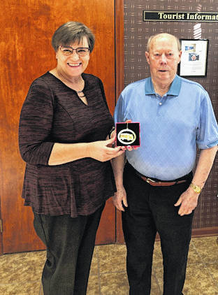 Provided photo Mainstreet Piqua Executive Director Lorna Swisher gives Charlie Sanders the first Sanders Dairy Made in Piqua ornament.