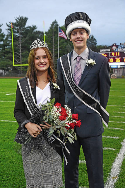 Ben Robinson|GoBuccs.com Hailey Weer and Zach Kuntz were crowned queen and king at the Covington football homecoming game Friday night against National Trail.