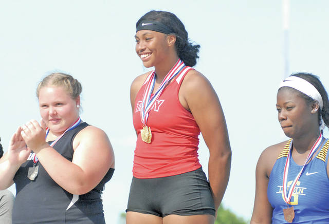 David Fong | Miami Valley Today file Troy's Lenea Browder stands atop the podium with her two state championship medals during the spring season. Browder officially signed her national letter of intent to continue her track and field career at Ohio State University.