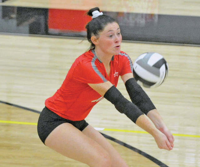 Josh Brown   Miami Valley Today Troy's Lauren Schmitz passes the ball during the district semifinal match against Beavercreek this season at Centerville High School. On Wednesday, Schmitz signed a national letter of intent to attend Stony Brook University.