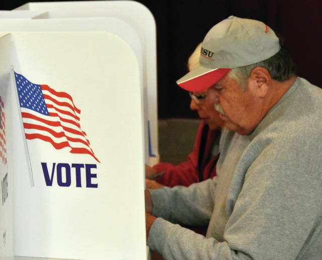 """John and Carol Talbot, of Pleasant Hill, cast their ballots at the First Brethren Church on Tuesday. In an early afternoon check with poll workers at several precincts, voter turnout was described as """"steady."""""""