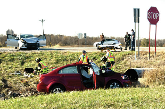First responders work at the scene of a two-car crash at the intersection of State Route 48 and State Route 185 on Tuesday afternoon.