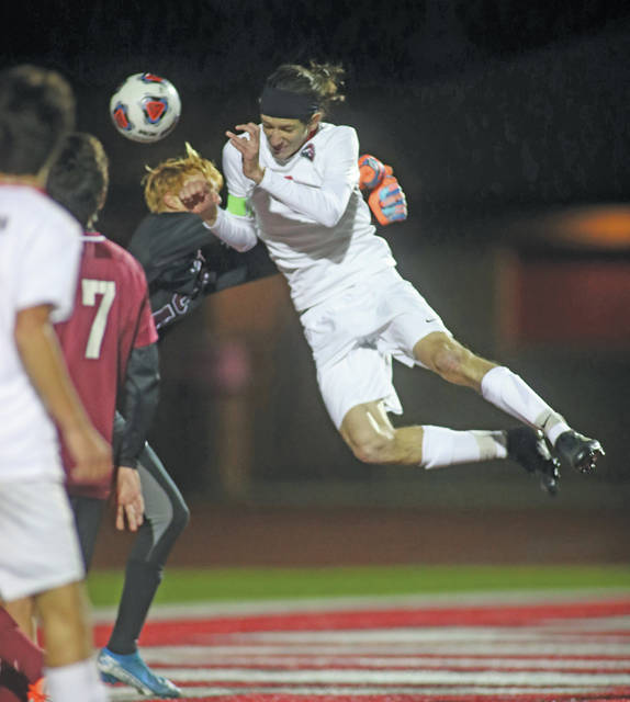 Lee Woolery | Miami Valley Today Tippecanoe's Jake Rowland heads the ball past Columbus Academy's goalie for the only score in the Red Devils' 1-0 victory in the Division II state semifinal game Wednesday at London High School.