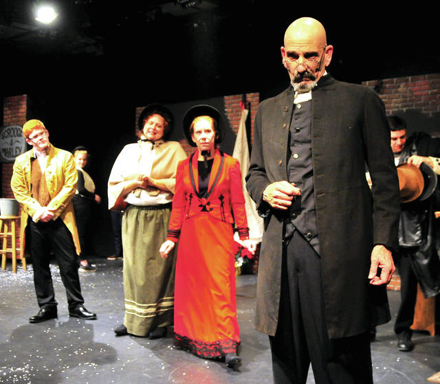 "Ebeneezer Scrooge, played by Michael Maxson of Conover, front right, plays a scene from the Troy Civic Theatrevproduction of ""A Christmas Carol,"" at the Barn in the Park during a Wednesday dress rehearsal. Visit troycivictheatre.com for dates, times and prices of the upcoming performance."