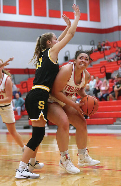 Lee Woolery | Miami Valley Today Troy's Tia Bass works in the paint during Monday night's season opener against Springfield Shawnee at the Trojan Activities Center.