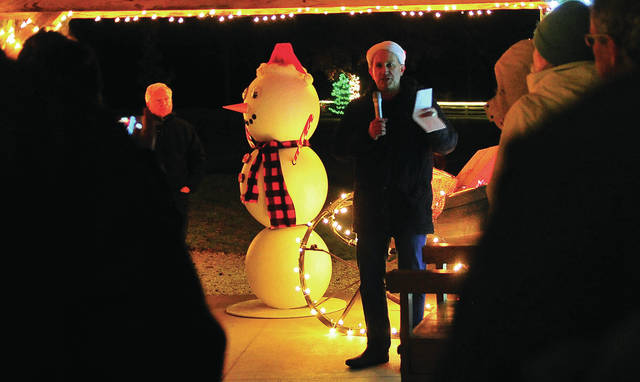 Miami County Park District Executive Director Scott Myers speaks to guests prior to the official lighting of the Holiday Lights at Lost Creek Reserve on Saturday.