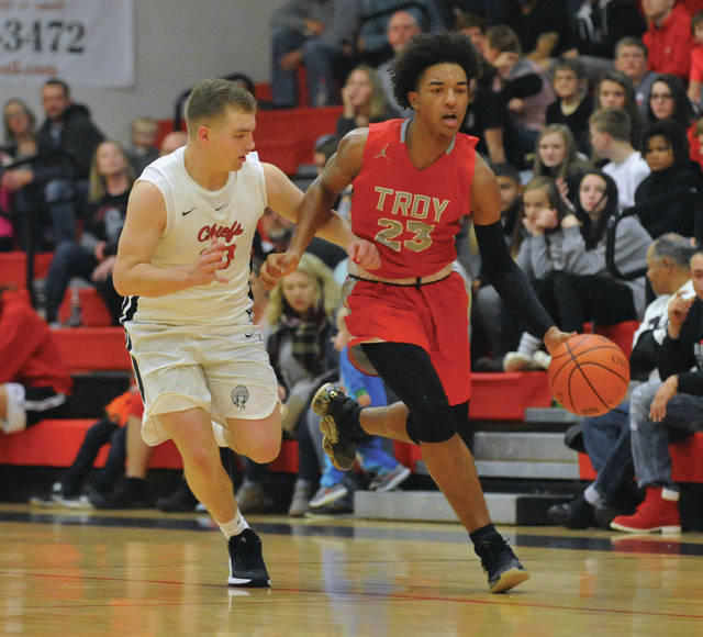 Josh Brown | Miami Valley Today Troy's Shaeden Olden runs the fast break after a steal during the Trojans' season-opening win Friday night at Bellefontaine.