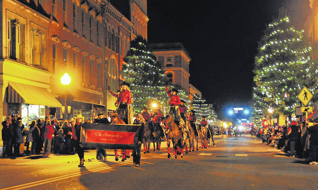 Mike Ullery | Miami Valley Today file photo The Renegades make their way down Main Street during the 2017 Mainstreet Piqua Holiday Horse Parade.