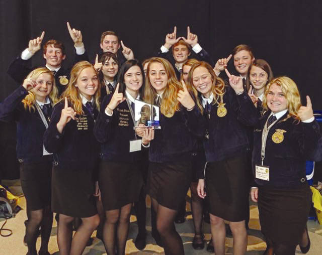 Provided photo Members of the Covington-UVCC FFA celebrate their win of the Model of Excellence award at the 92nd National FFA Convention & Expo, which took place in Indianapolis, Ind.