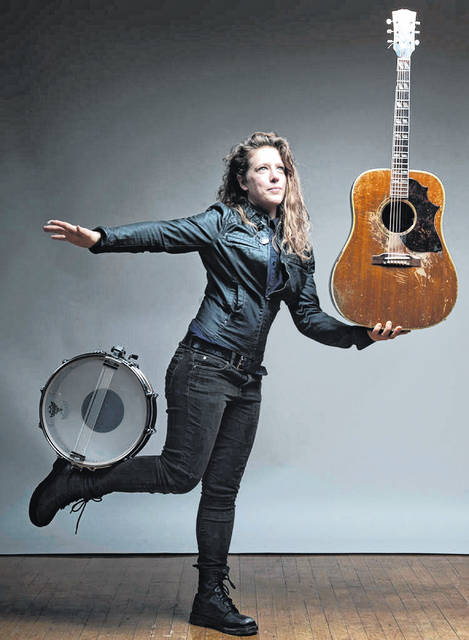 Provided photo Columbus-based Kelly Zullo & the Invisible Circus will bring funky, finger-picking acoustic guitar to downtown Troy on Saturday, Dec. 14, making a special appearance at the Leaf & Vine for a show starting at 9:30 p.m.