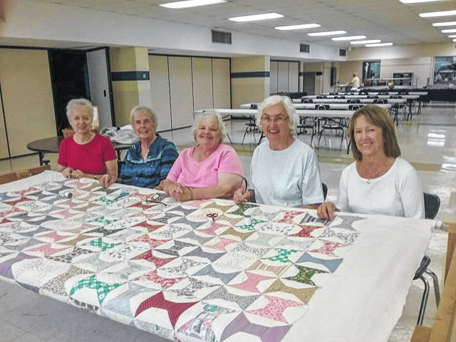 Provided photo Members of St. Boniface and St. Mary parishes spent many hours working on the Spool Pattern Quilt to be raffled on Dec. 7. Pictured are (left to right) Rose Hemm, Janet Poling, Cindy Nelson, Dolores Latham, Betty Elliott.