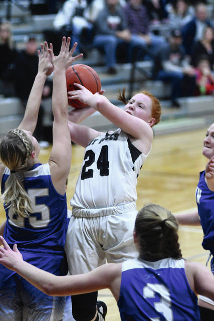 Ben Robinson|GoBuccs.com Covington's Claudia Harrington shoots over Fairlawn's MaCalla Huelskamp Saturday night.