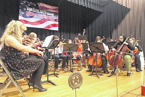 Provided photo Members of the Troy High School orchestra perform during the Van Cleve Sixth Grade Building's annual Veterans' Breakfast and Honor Program.