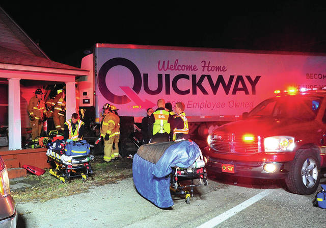 Fire and EMS from multiple agencies work to reach victims of a crash that involved a pickup truck and a semi that both crashed into a home in Alcony on Tuesday evening.