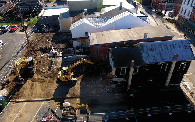 Demolition has begun on six commercial buildings, all owned by Marias Technology, on the east side of High Street in downtown Covington.