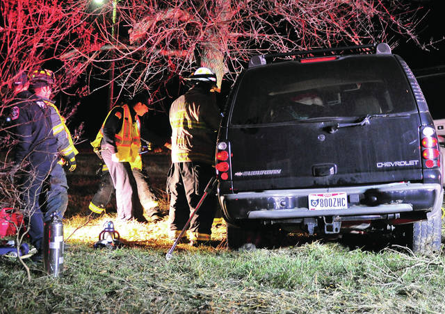 First Responders from Piqua and Covington work to free a victim who was trapped in her vehicle following a crash on Washington Road on Friday evening.