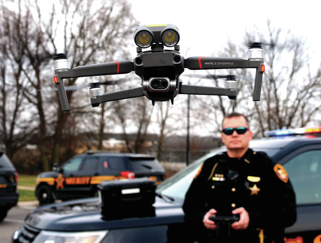 Deputy Richard Manns pilots the Miami County Sheriff's Office's new drone during a demonstration flight on Sunday.