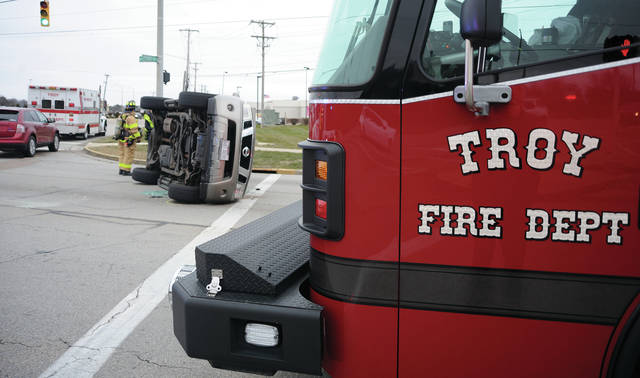 A vehicle rests on its side following a two-vehicle crash at West Main Street and Experiment Farm Road d on Tuesday morning. There were no serious injuries.