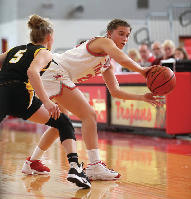 Lee Woolery | Miami Valley Today Troy's Elise McCann passes the ball around Sidney's Kelsey Kizer Saturday at the Trojan Activities Center.