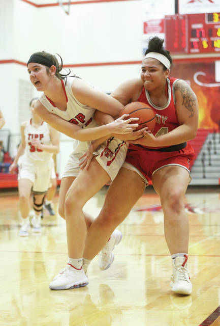 Lee Woolery | Miami Valley Today Tippecanoe's Katie Hemmelgarn and Troy's Tia Bass battle for a loose ball Monday night at Tippecanoe High School.
