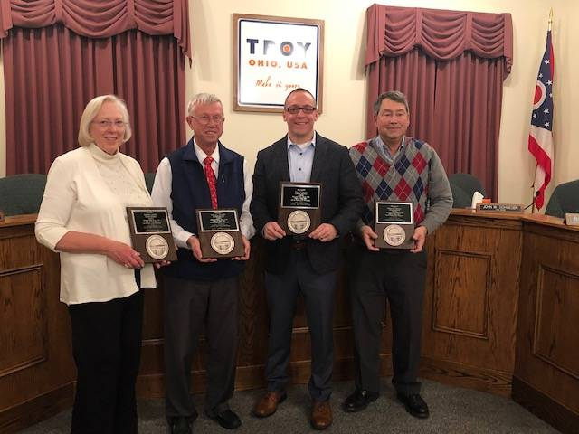 From left, President Marty Baker, Mayor Michael Beamish, Sixth Ward Councilman Brock Heath and First Ward councilman Tom Kendall were presented plaques recognizing their years of public service. Baker served as a second ward council member from Jan. 1, 2000 to Dec. 31, 2007 then as president of council from Jan. 1, 2008 through the end of this year. Beamish began his service as a council member at-large on Jan. 1, 1994 to Dec. 31, 2003 and as mayor since Jan. 1, 2004. Kendall served as first ward council member since Sept. 6, 2005. Heath began his service on council Jan. 1, 2014.