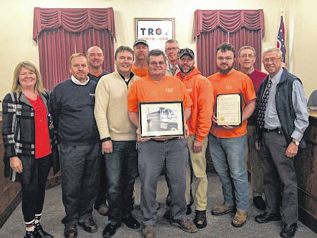 On Wednesday, city of Beavercreek's City Manager Pete Landrum (fourth from the left) and Director of Public Administrative Services Mike Thonnerieux (fifth from the right) thanked the city of Troy's eight city employees and supportive administration, for their help with the clean-up efforts following the aftermath of an EF-3 tornado on May 27.