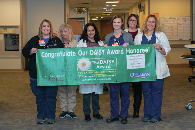 UVMC DAISY Award winner for November Mandi Crump, third from right, is recognized with the help of coworkers.