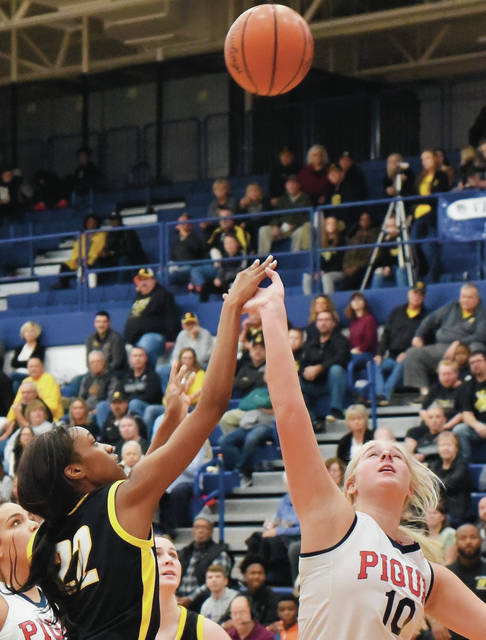 Sidney's Samantha Reynolds shoots over Piqua's Aubree Schrubb at Piqua on Friday.