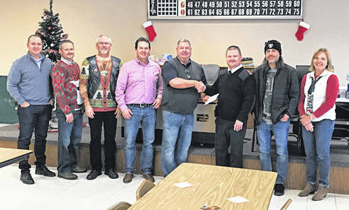 Provided photo Miami Valley Steel Services of Piqua donated $7,600 on Friday during their employee Christmas party to the Piqua Salvation Army to help local families for the holidays. Pictured, from left, are MVS employees, including Nick Straka, Ken Long, Mike Sora, Len Stahl, Lou Moran, Salvation Army Major Robert Kramer, Shay Thompson and Jill Kindell. Miami Valley Steel does this each year at the holidays, where employees donate and the company matches the donation to the Salvation Army.