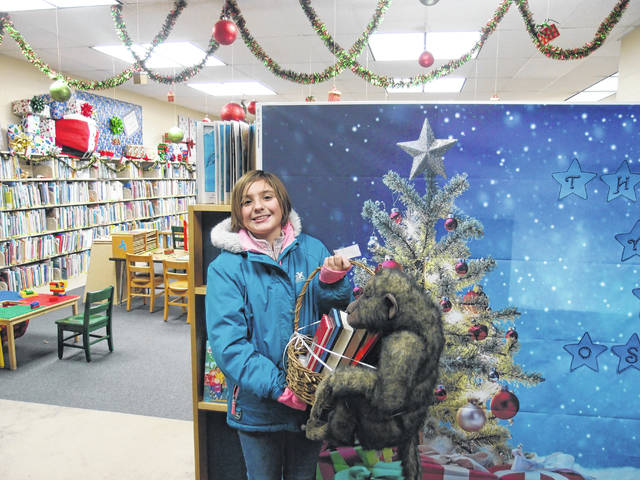 On Saturday, Dec. 14, the Milton-Union Public Library held a holiday open house where the public came to see the new renovations and children's room, which was made available by a donation from the Joann Osborne estate. Santa was at the library, and the library also had several giveaways. Abigail Mitchell was the winner of the fourth and fifth grade basket.