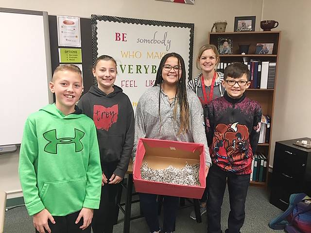 Provided photo Van Cleve Sixth Grade Building students (from left-right) Elijah Buschur, Alyssa Knapinski, Layla Lucas and Colton Trochelman, along with student council co-advisor Katie Rindler, show off some the pop tabs students collected in support of The Ronald McDonald House.