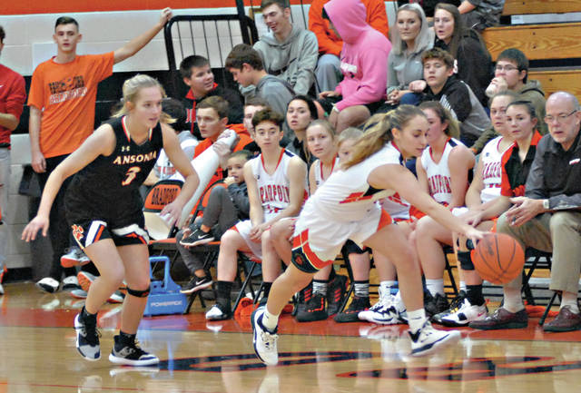 Rob Kiser|Miami Valley Today Bradford's Abby Gade reaches for the ball as Ansonia's Lauren Burns closes in.