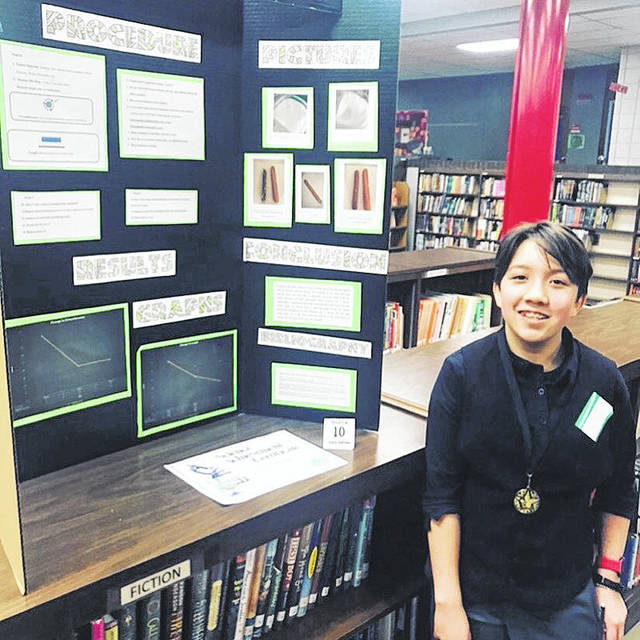 Provided photo Troy Junior High School student Truth Santiago won the Troy City Schools Science Fair for her project on desiccants (drying agents).