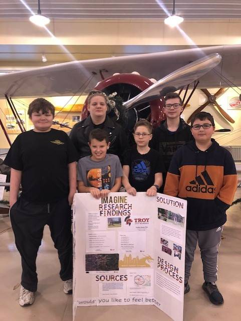 """Members of the WACO Air Museum and Learning Center's First LEGO League robotics club """"Golden Dragons"""" share their """"Best Project"""" poster, which won an award at the U.S. Air Force Museum competition on Dec. 7."""